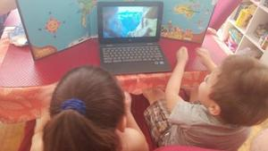 boy and girl watching read a long together