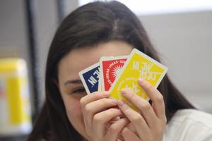 student with cards