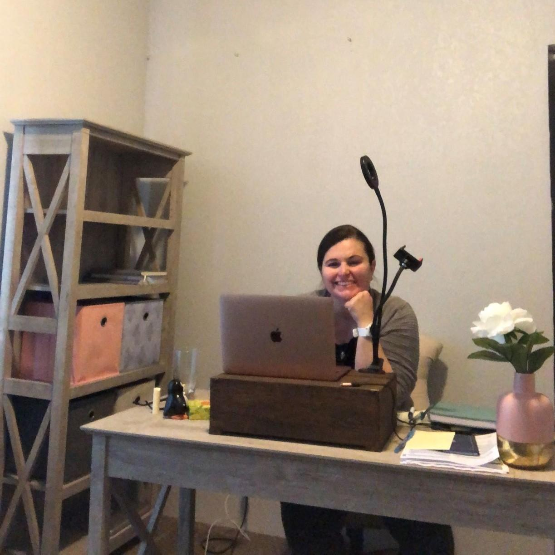 Woman at desk.