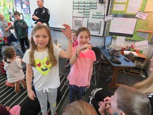 Students get a chance to try on the handcuffs.