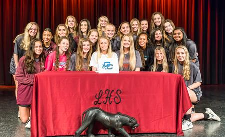 Katelyn Smith and her teammates at her signing