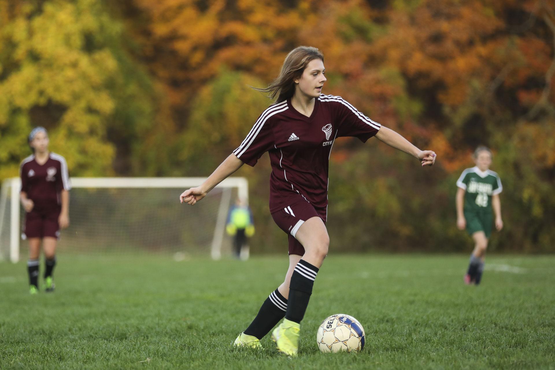 Soccer player kicking a ball