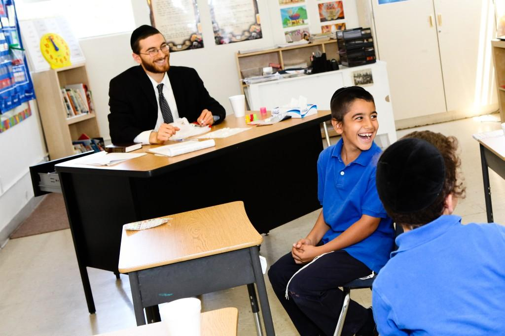 Rabbi Goldstein smiling with his students