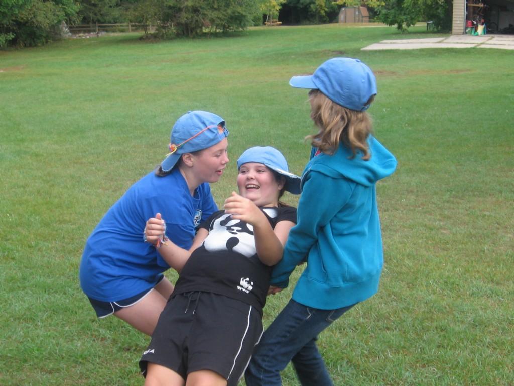 three students play trust fall