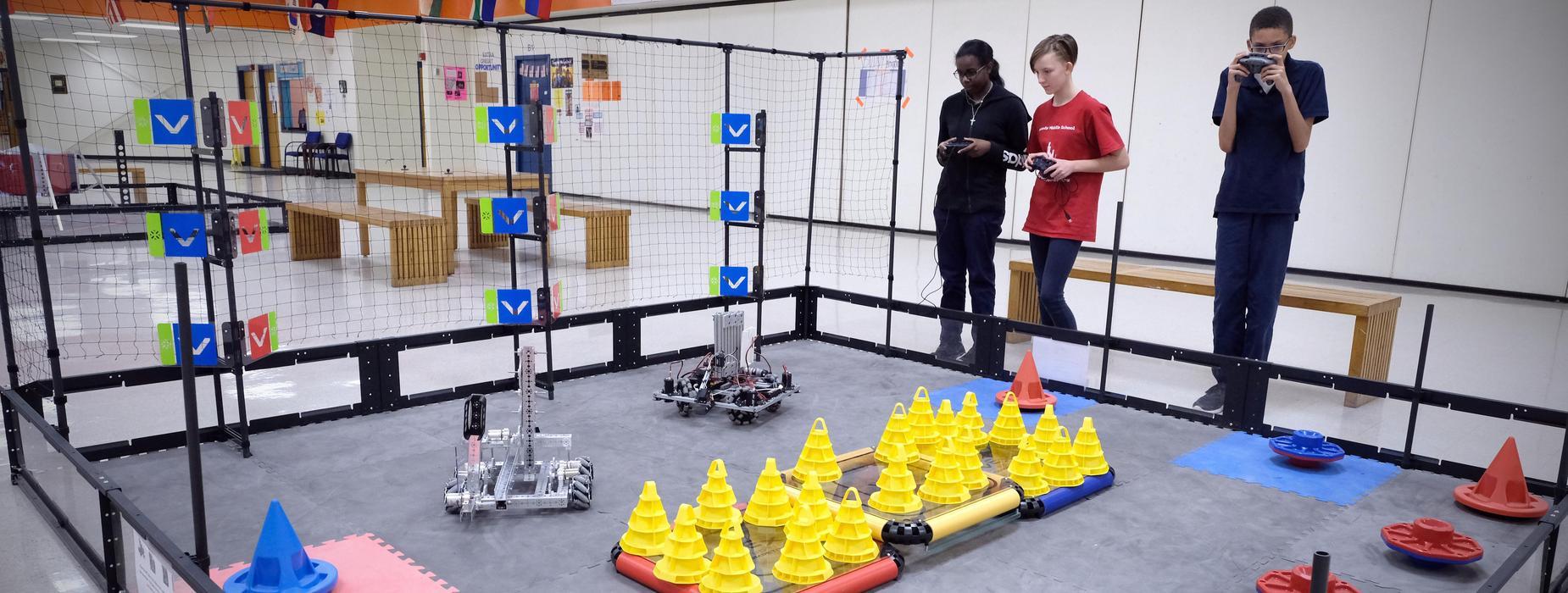 Kids participating in a robotics event