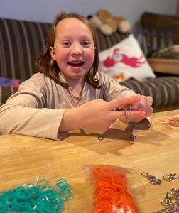 Lily Ricigliano, a Jefferson School 5th grader and member of the Early Act Club, makes rubber band lanyards for local first responders as part of a club initiative.