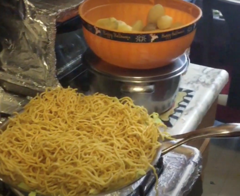 photo of chow mein being prepared