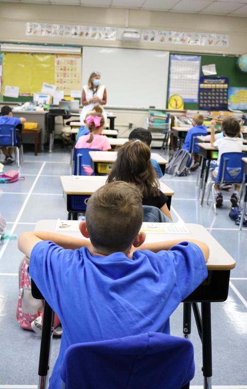 Photo of students listening to teacher