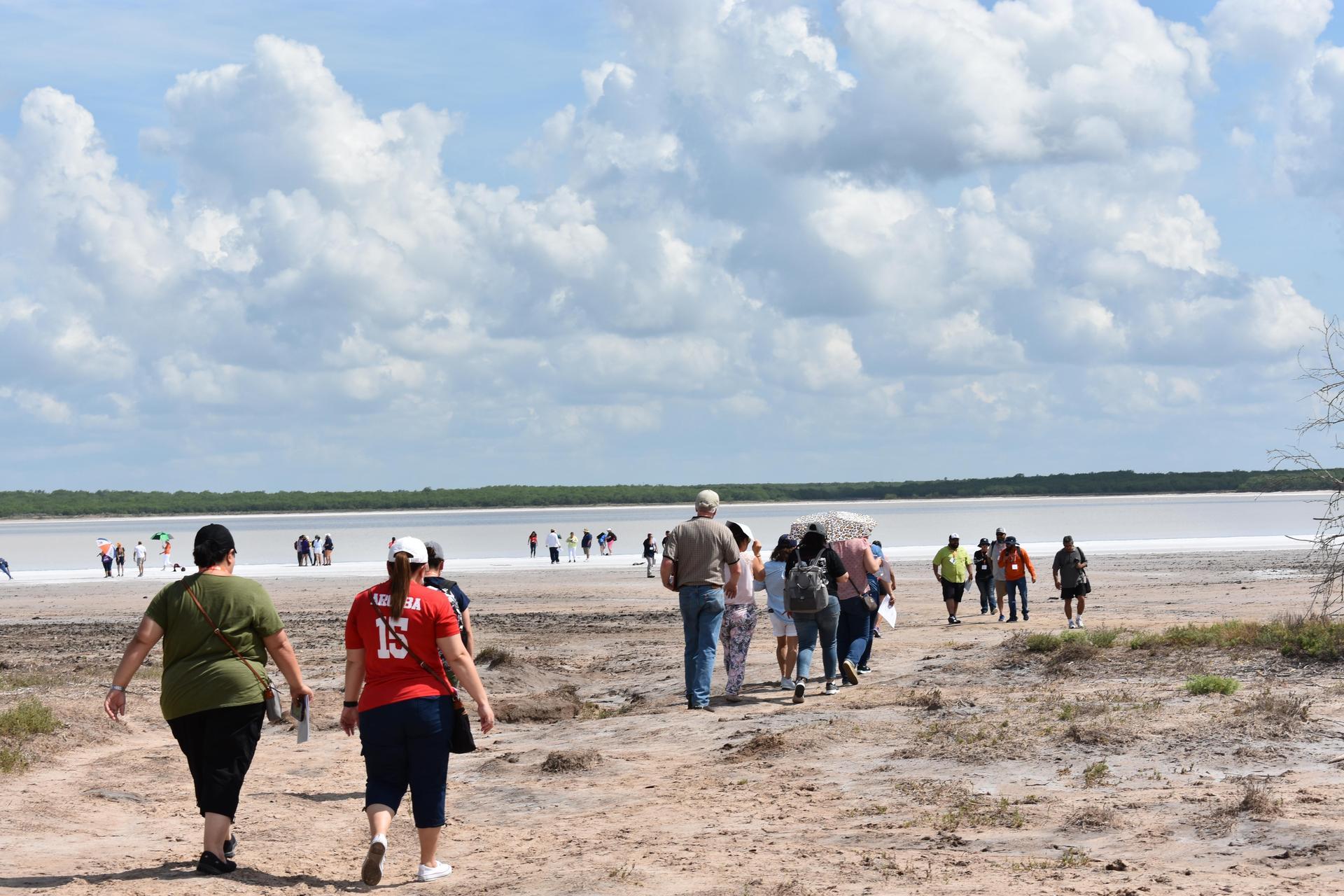 Group walking towards water