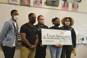 Shakir Robinson, a BHS alumnus, presented senior Alayna Holmes with a $10,000 scholarship Thursday. Holmes was not told about the scholarship beforehand and was surprised by the presentation.