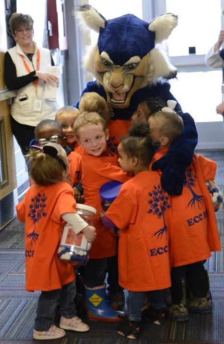 ECC kids hug the RSD Wildcat mascot