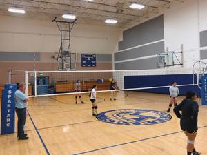 volleyball team practicing in newly renovated gym