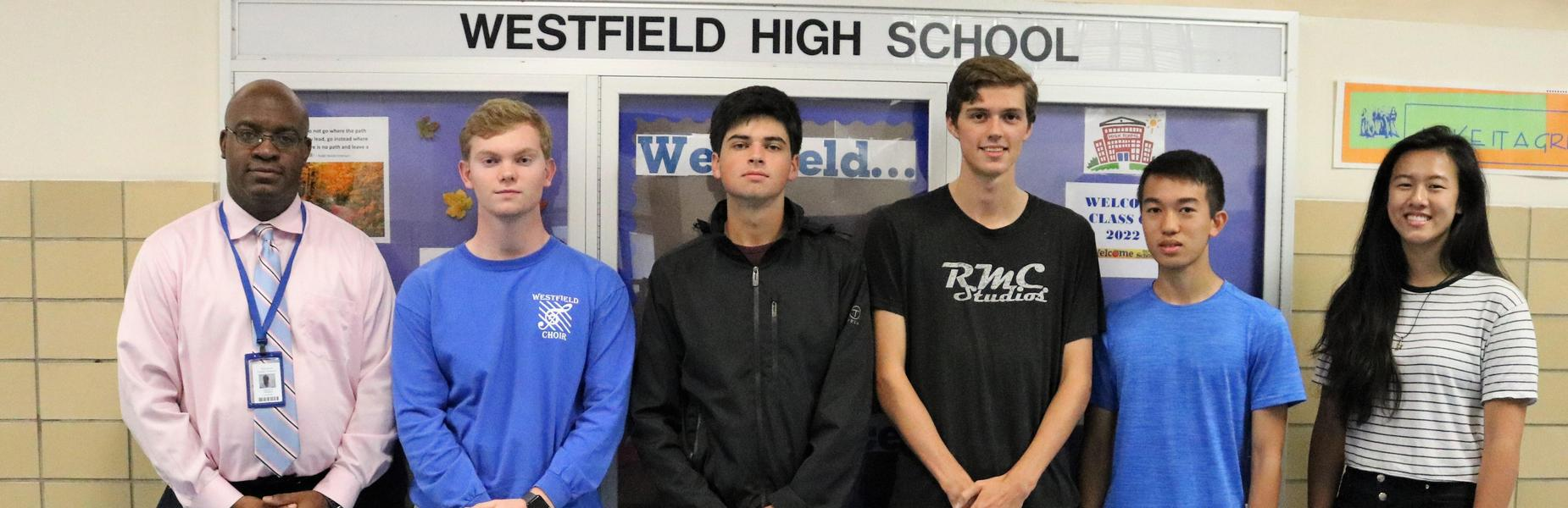 Westfield High School juniors Valerie Chang and Kurt Hu and seniors Alexander McGrail, Timothy Miller, Jacob Singman, and Andrew Zanfagna received the highest score possible on portions of the September 2018 ACT standardized tests, according to recent reports received by the school.  Pictured here with principal Dr. Derrick Nelson.