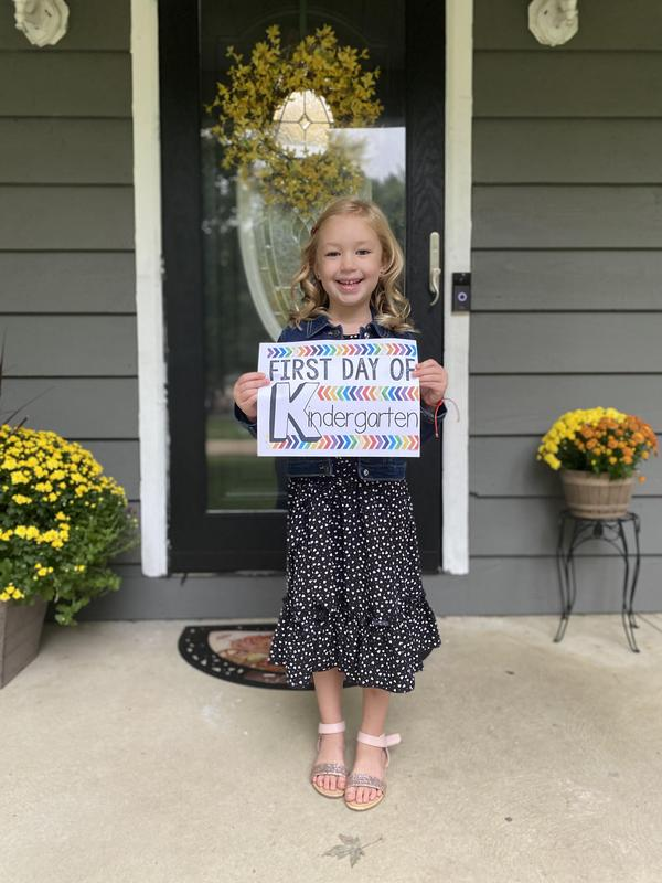 Kindergarten Student holding sign