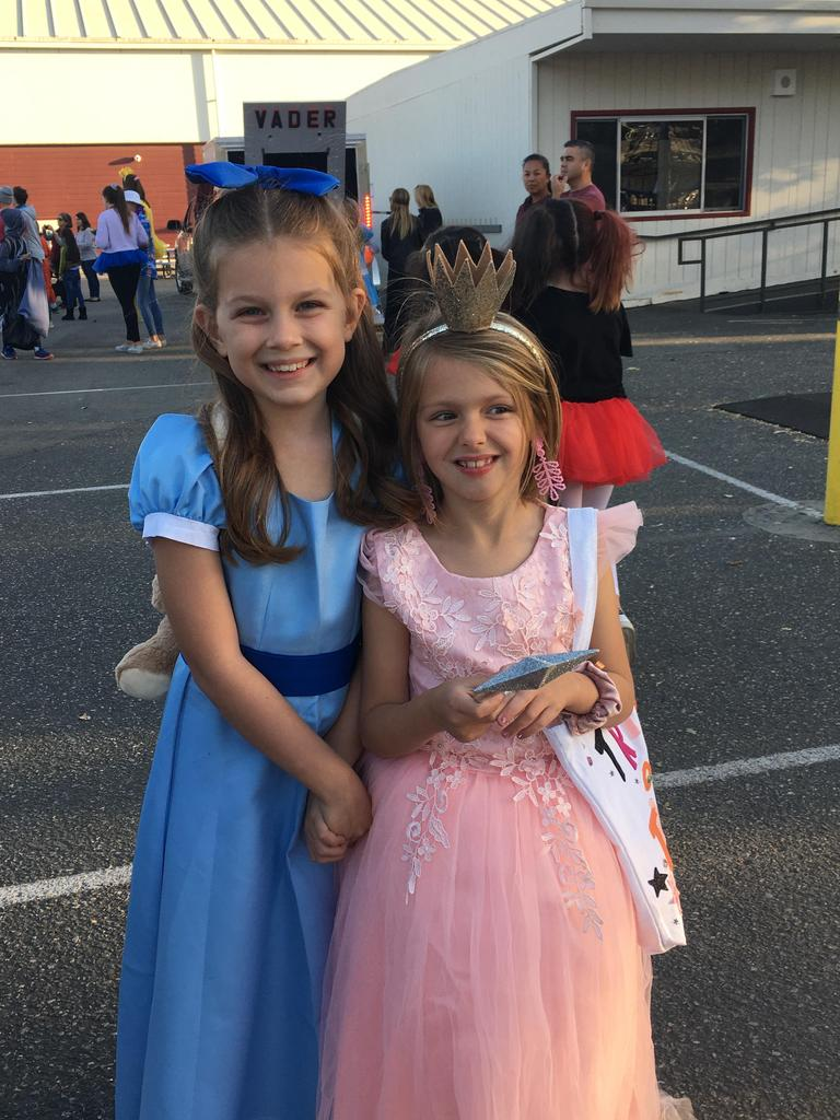 two girls dressed in princess costumes