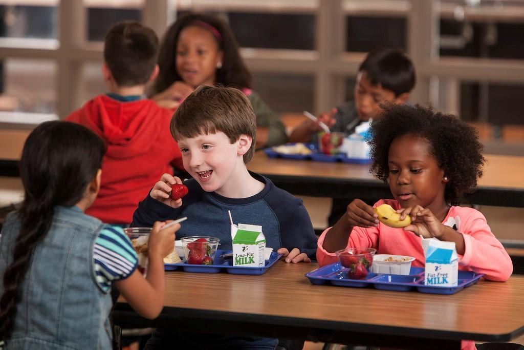 Stock photo of children eating lunch