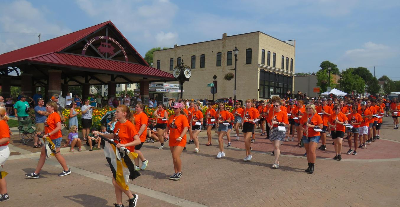 TK Trojan marching band marching down Main Street in Middleville's Heritage Day parade.