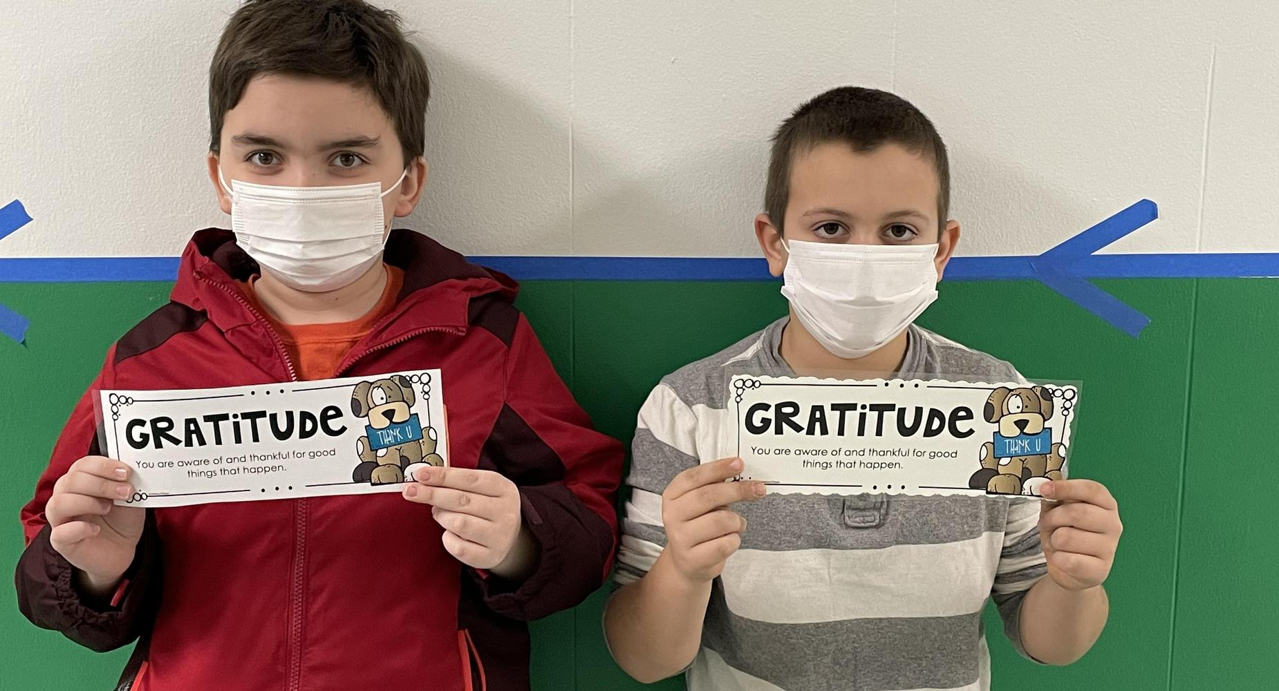 Students with Gratitude signs
