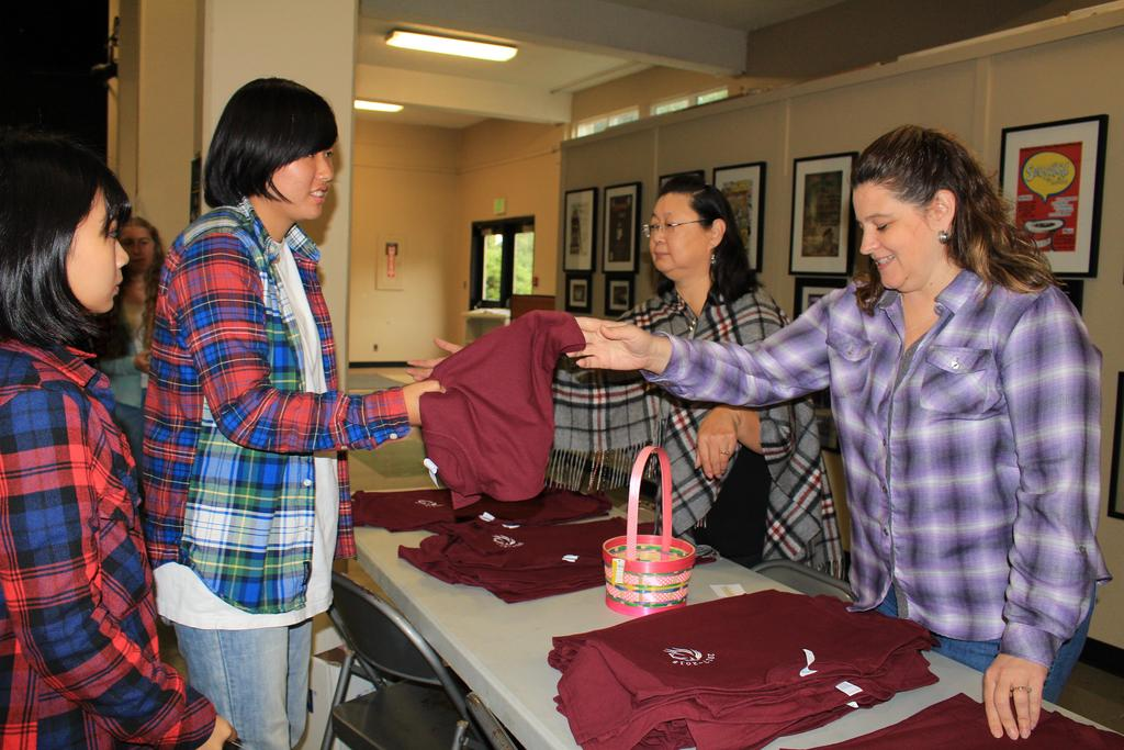 Students receiving class T-shirts