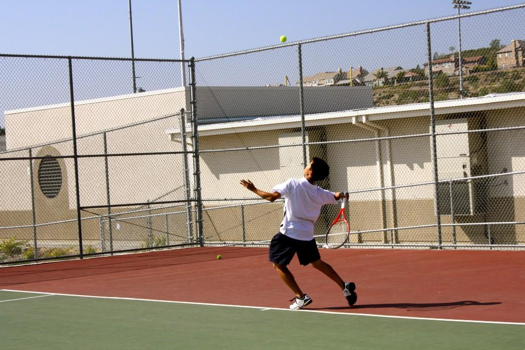 Tennis player in mid serve