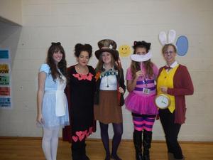Teachers dressed as Alice in Wonderland characters