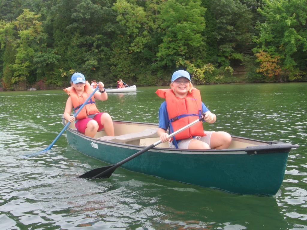 two girls in a canoe