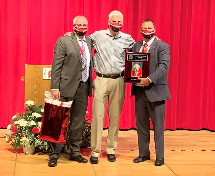 Photo of Mr. Roger Martin, Mr. Jay Muldoon, and Superintendent Billy Smith presenting Mr. Muldoon with plaque for being named Teacher of the Year
