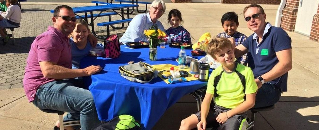 Parents join their students at an outdoor lunch