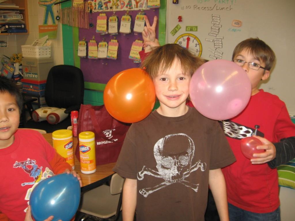 students stick balloons to their hair with static
