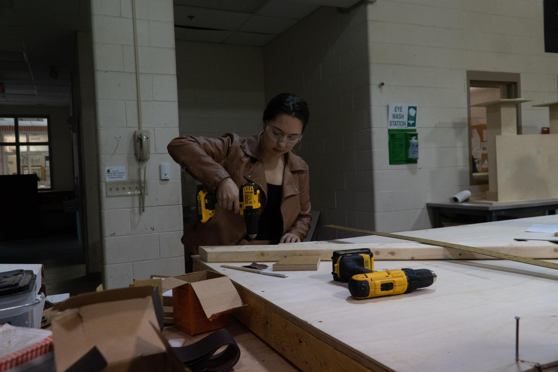 Girl using drill