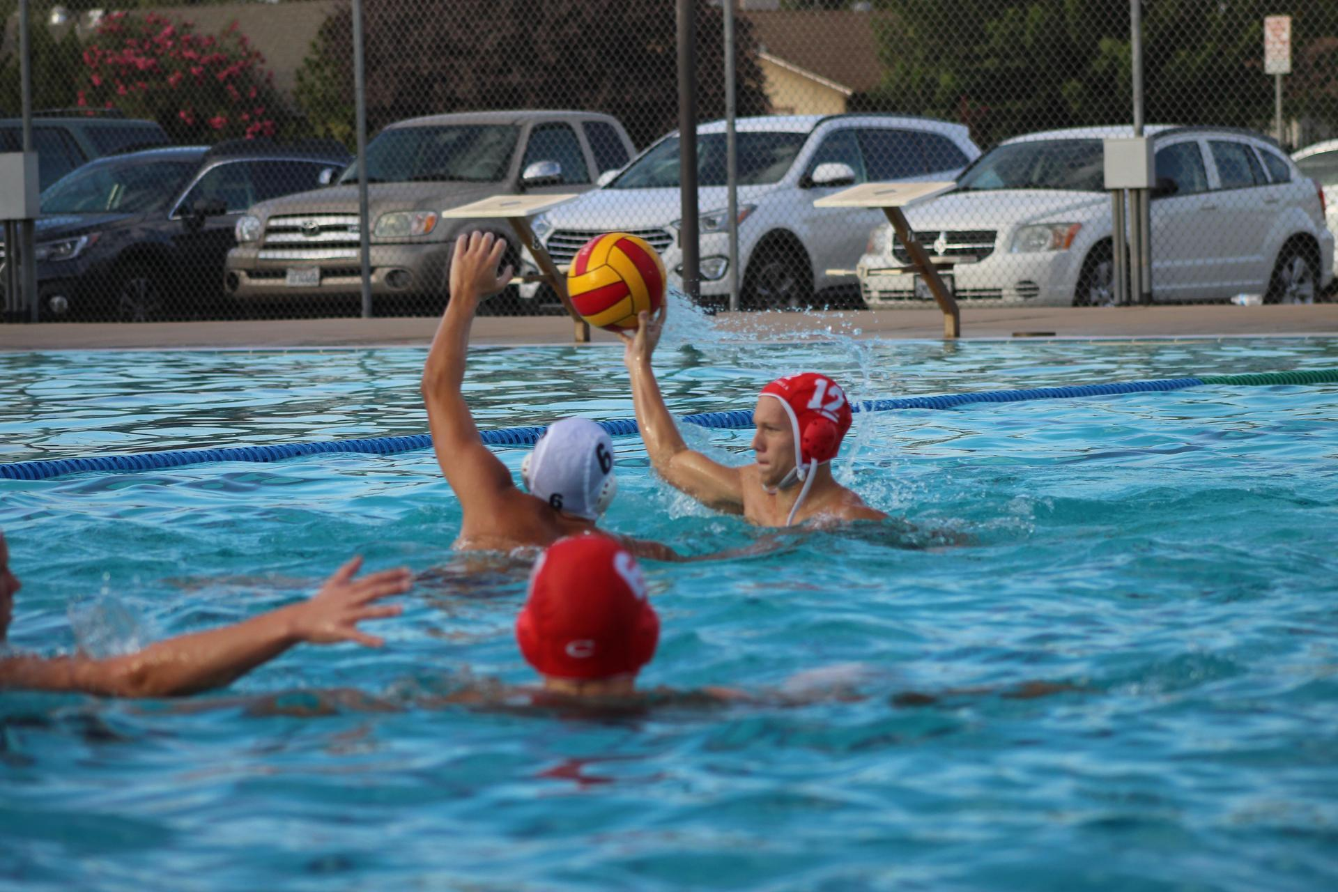 Boys playing water polo against Yosemite