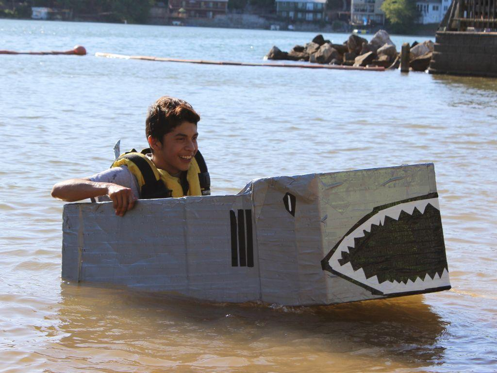 student in shark boat