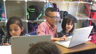 3 students on Chromebooks