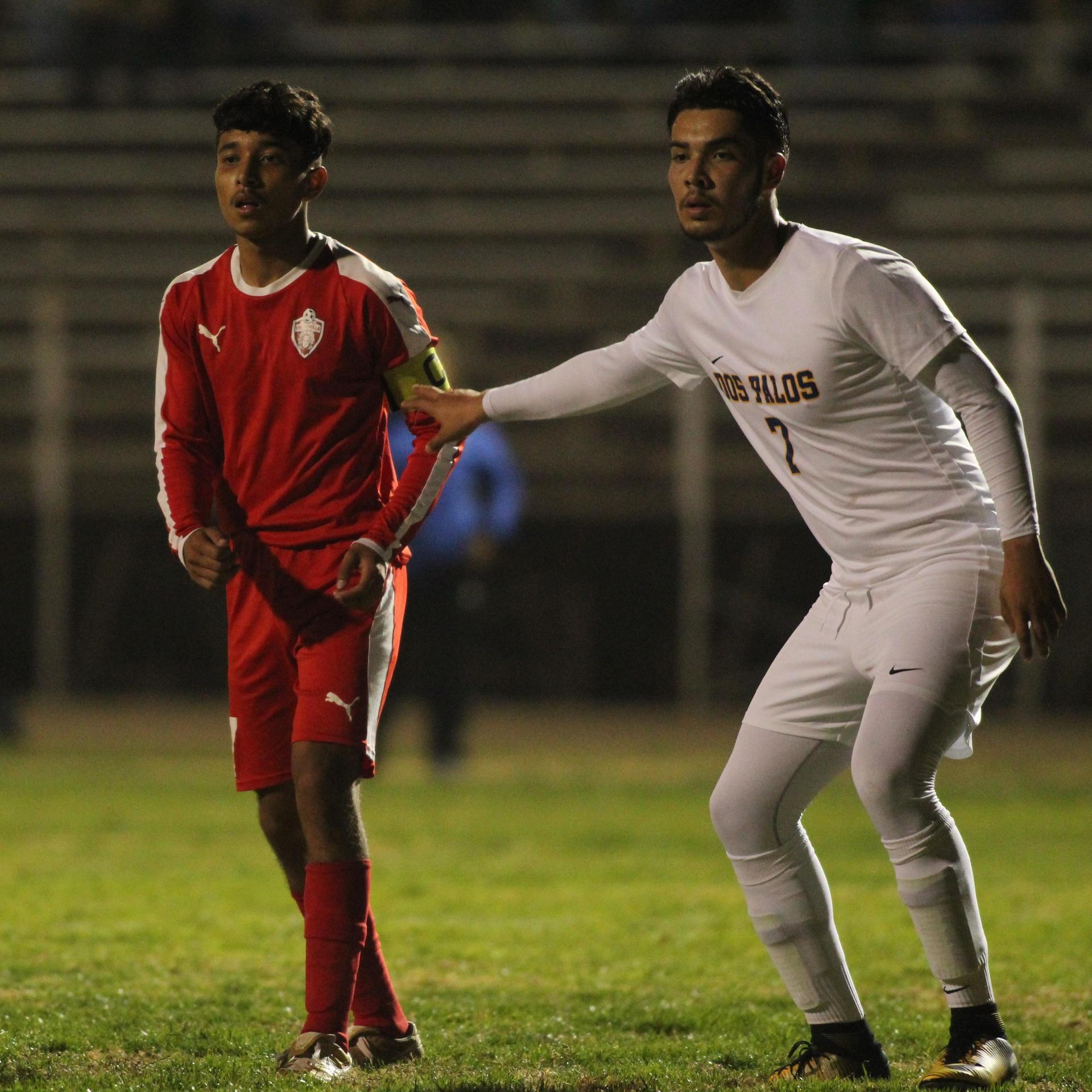 Luis Reyes with opposing team