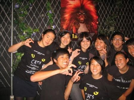 Nine students posing outside CATS performance