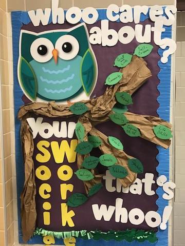 decorative owl display encouraging kindness