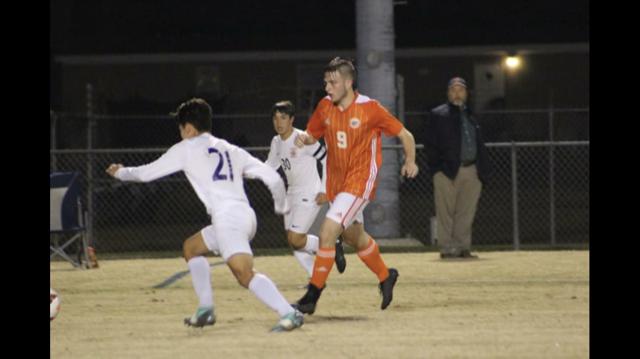 Bradean Vidrine kicking the soccer ball.