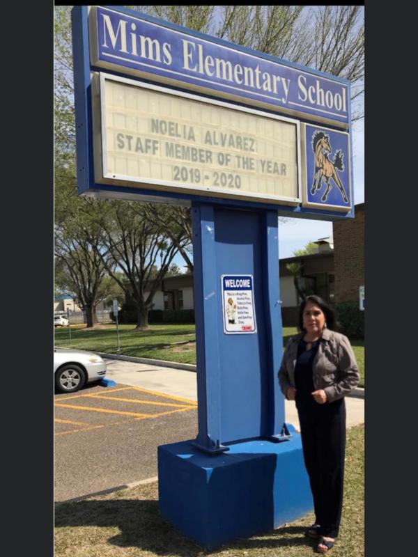 mrs. alvarez in from of school marque