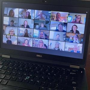 Teachers attend a Zoom meeting.