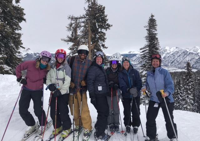 Our child find team out skiing on the slopes posing for a group photo