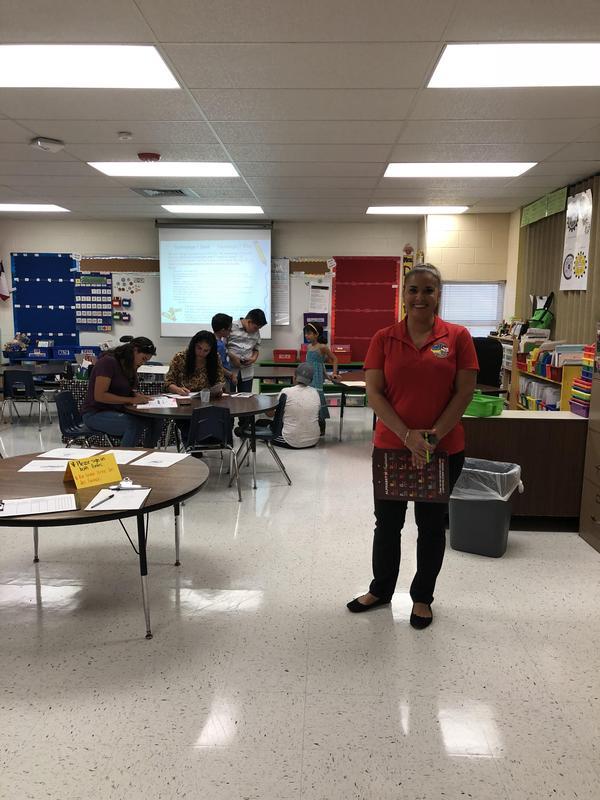 Mrs. Serda welcoming parents in her room.