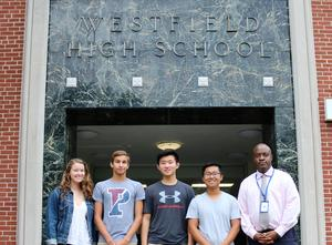 Westfield High School seniors Austin Chen, Madeline Reynders, Edward Xing, and Zachary Youssef have been named semifinalists in the 2019 National Merit Scholarship Competition.  They are pictured here with WHS principal Dr. Derrick Nelson.