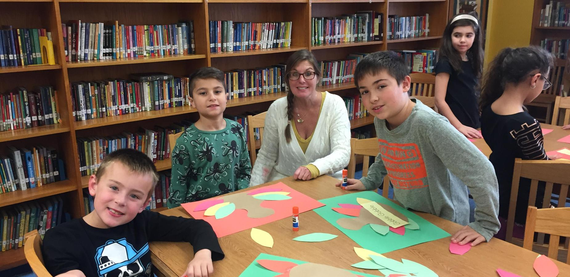 Students working on Thanksgiving crafts