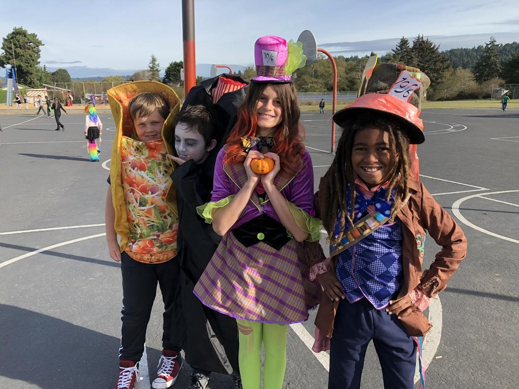 2 Mad Hatters, a taco, and a headless person costumes