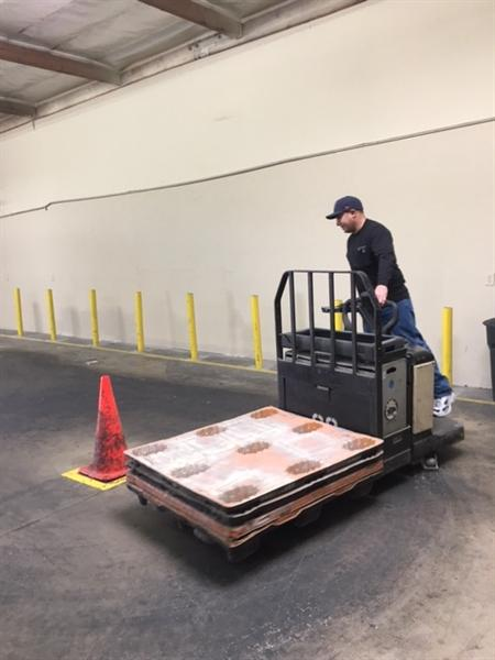 Student practicing driving fork lift