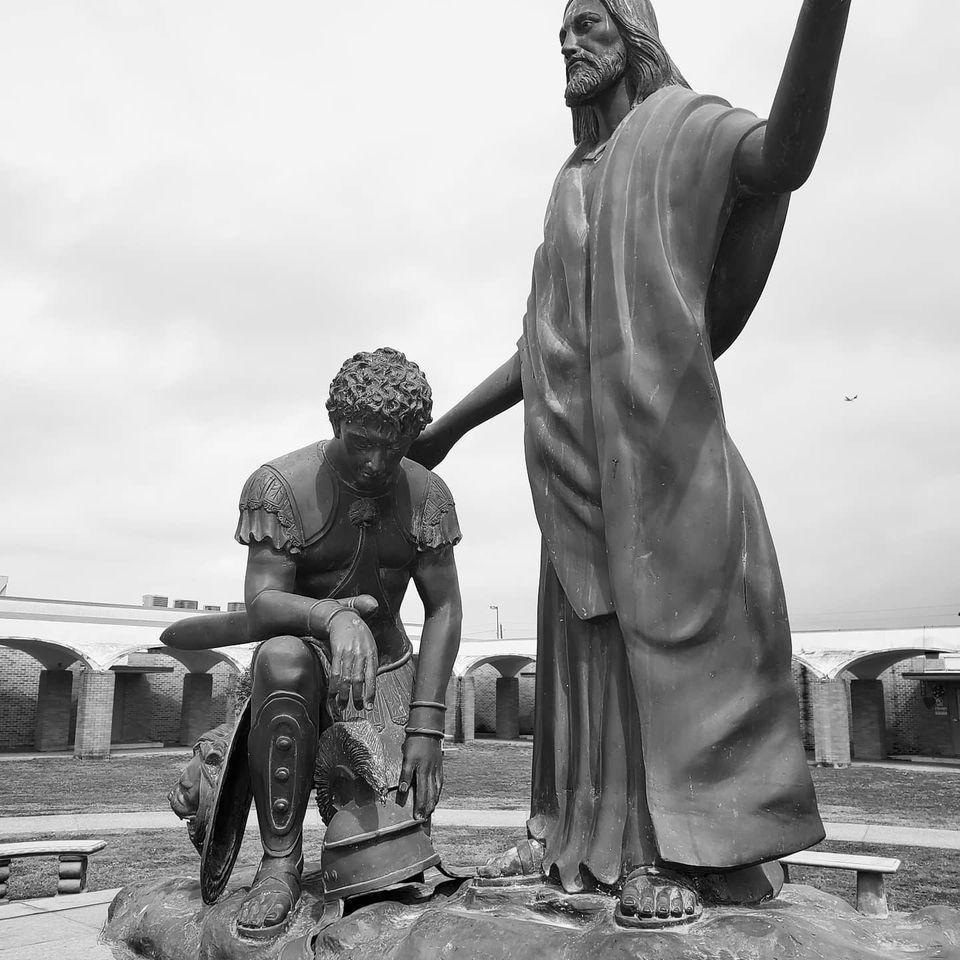 Centurion kneeling before Christ