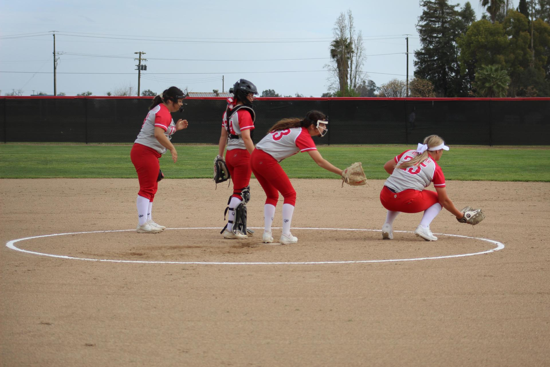 Varsity girls playing softball against Sierra