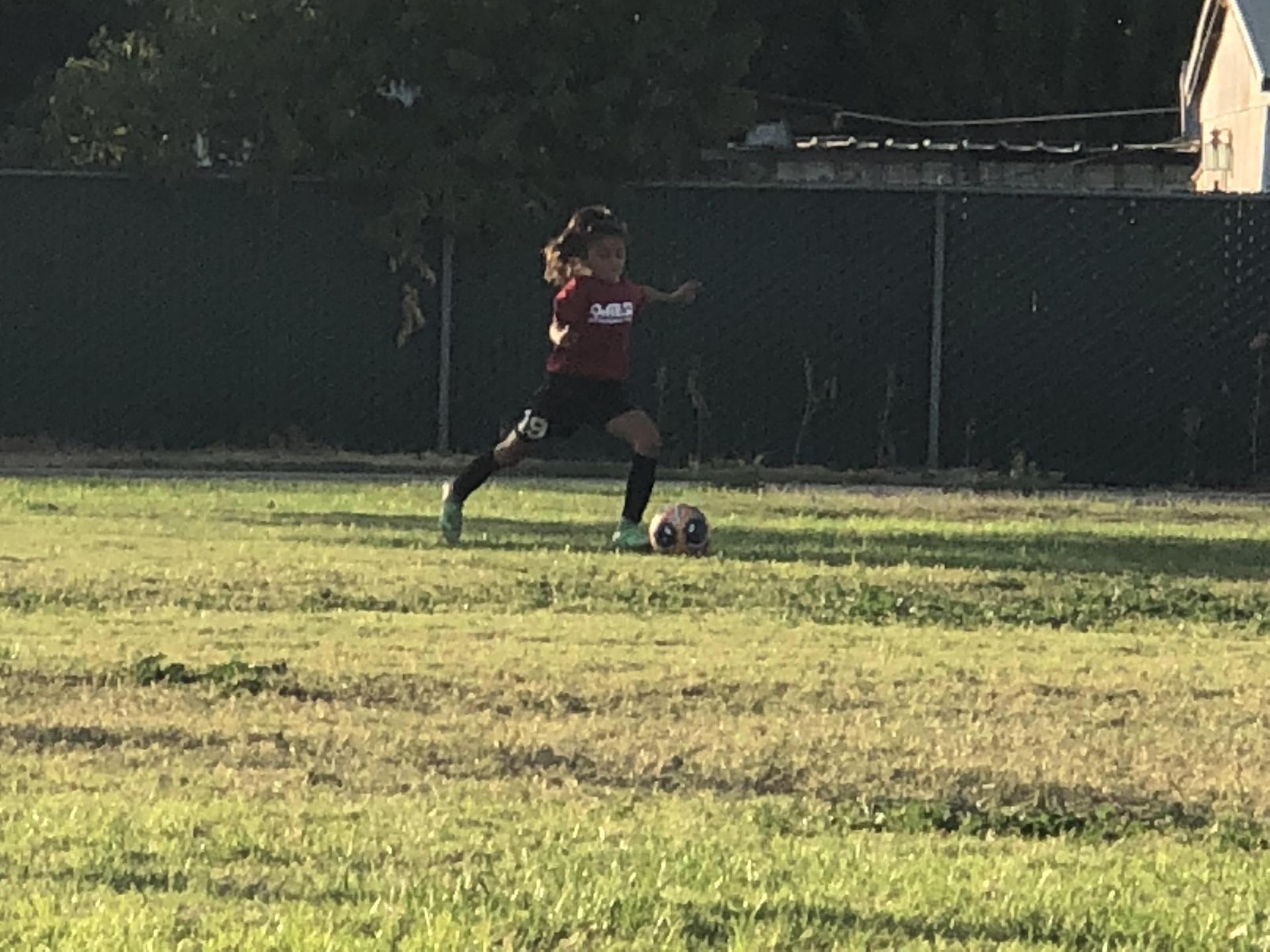 Bianca Kicking Ball