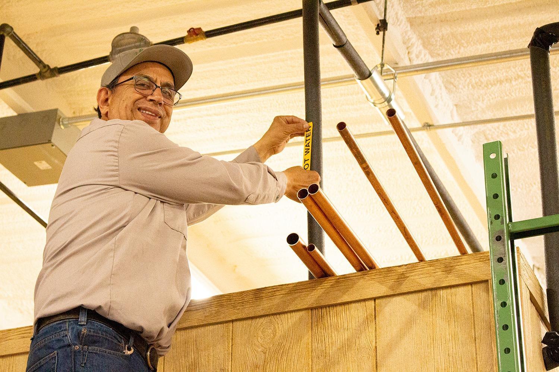 man installing copper lines