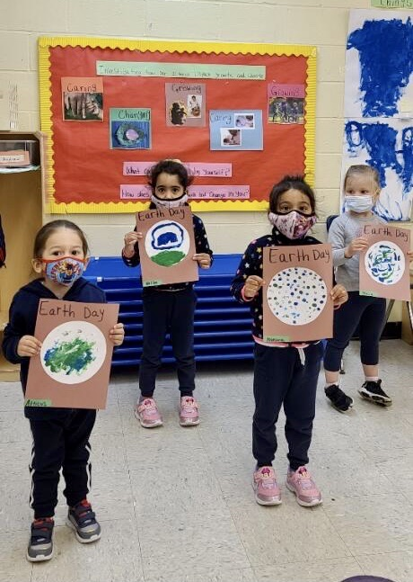 Pre K draws a poster about the Earth
